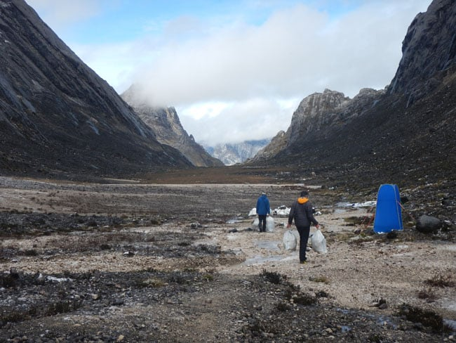 garbage collecting at carstensz pyramid base camp